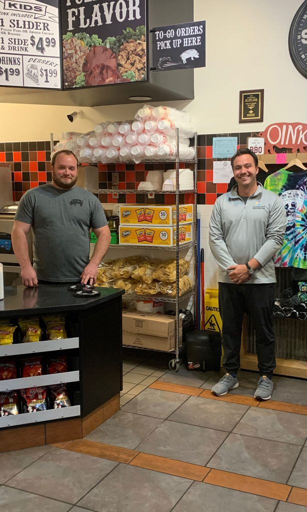 Two men standing by restaurant counter