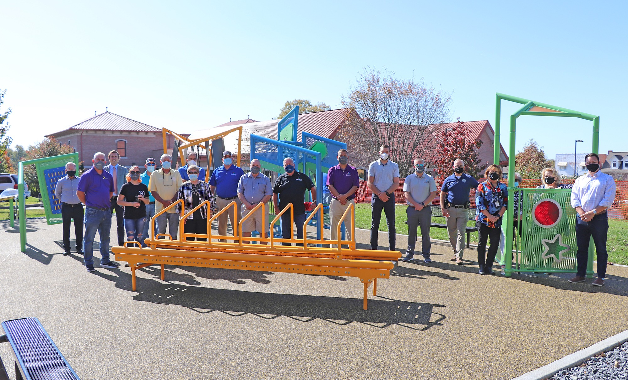 group of people standing on playground