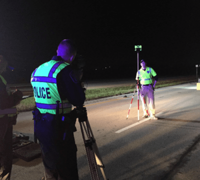 Officers in the road at night