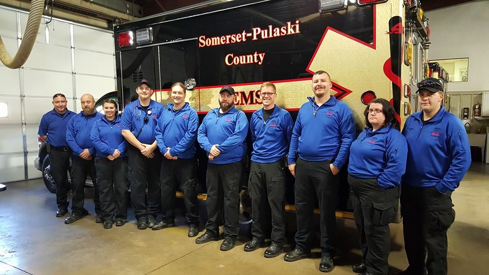 Somerset- Pulaski County EMS team standing in front of an ambulance.