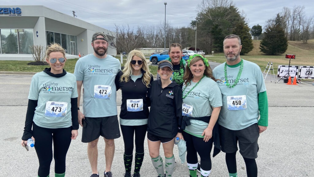 group of people wearing healthy somerset t-shirts at a 5K race