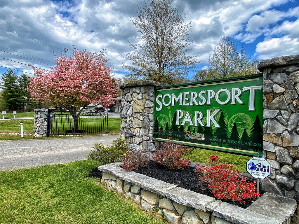 stone sign that says Somersport Park
